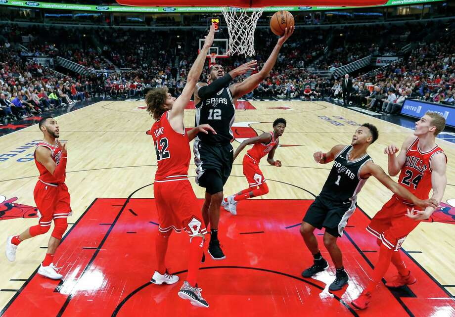 San Antonio Spurs forward LaMarcus Aldridge (12) goes to the basket against Chicago Bulls center Robin Lopez (42) during the first half of an NBA basketball game, Saturday, Oct. 21, 2017, in Chicago. (AP Photo/Kamil Krzaczynski) Photo: Kamil Krzaczynski, Associated Press / FR136454 AP
