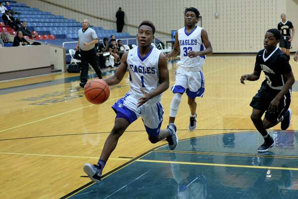 Trejon Ware (1) of Willowridge drives towards the hoop during the second half of a pool game between the Willowridge Eagles and the Sam Houston Tigers at the Ft. Bend ISD Tournament on Thursday December 8, 2016, Wheeler Fieldhouse, Sugar Land, TX.