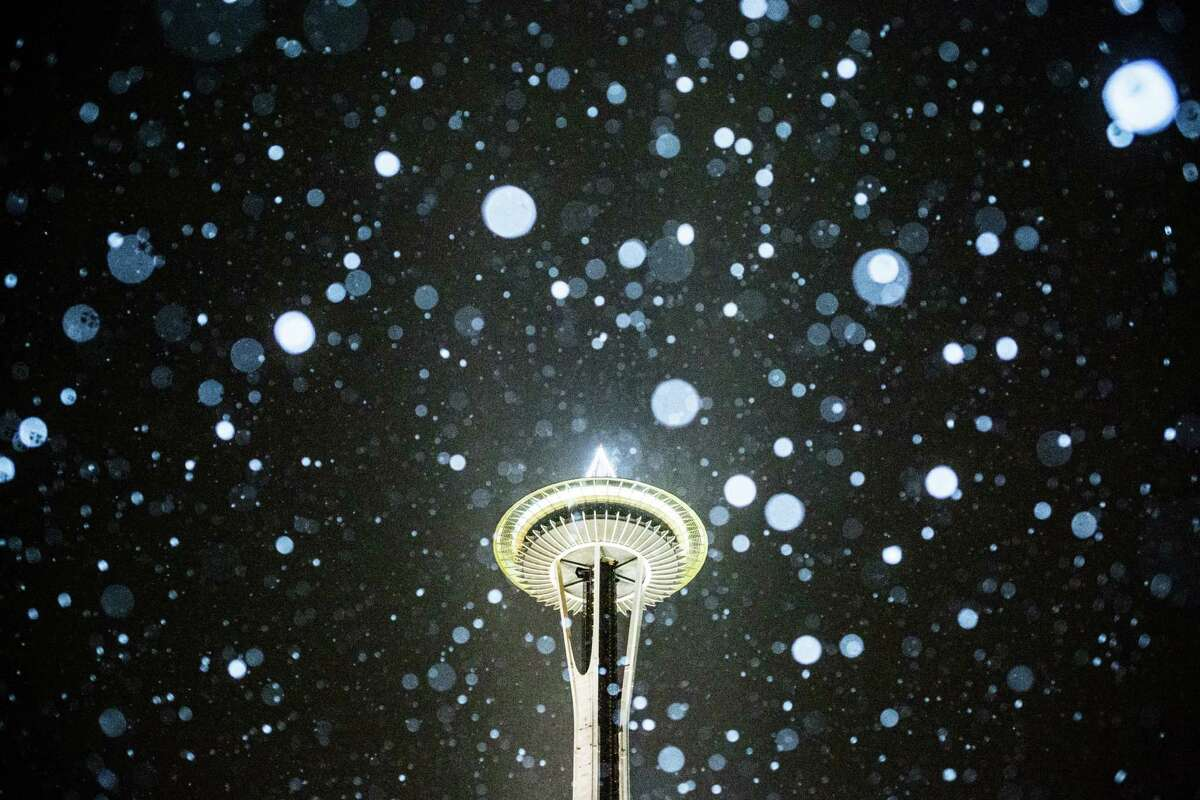 The Space Needle during the first snowfall of the season, Thursday, Dec. 8, 2016.