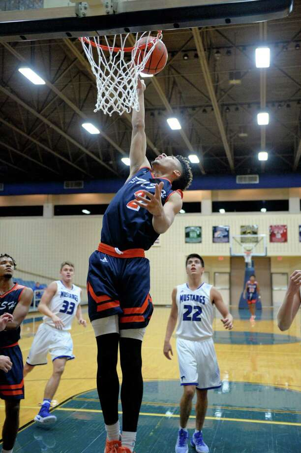 Kyle Slater (2) of Bush attempts a lay-up during the second half of a pool game between the Bush Broncos and the Friendswood Mustangs at the Ft. Bend ISD Tournament on Thursday December 8, 2016, Wheeler Fieldhouse, Sugar Land, TX. Photo: Craig Moseley, Houston Chronicle / ©2016 Houston Chronicle