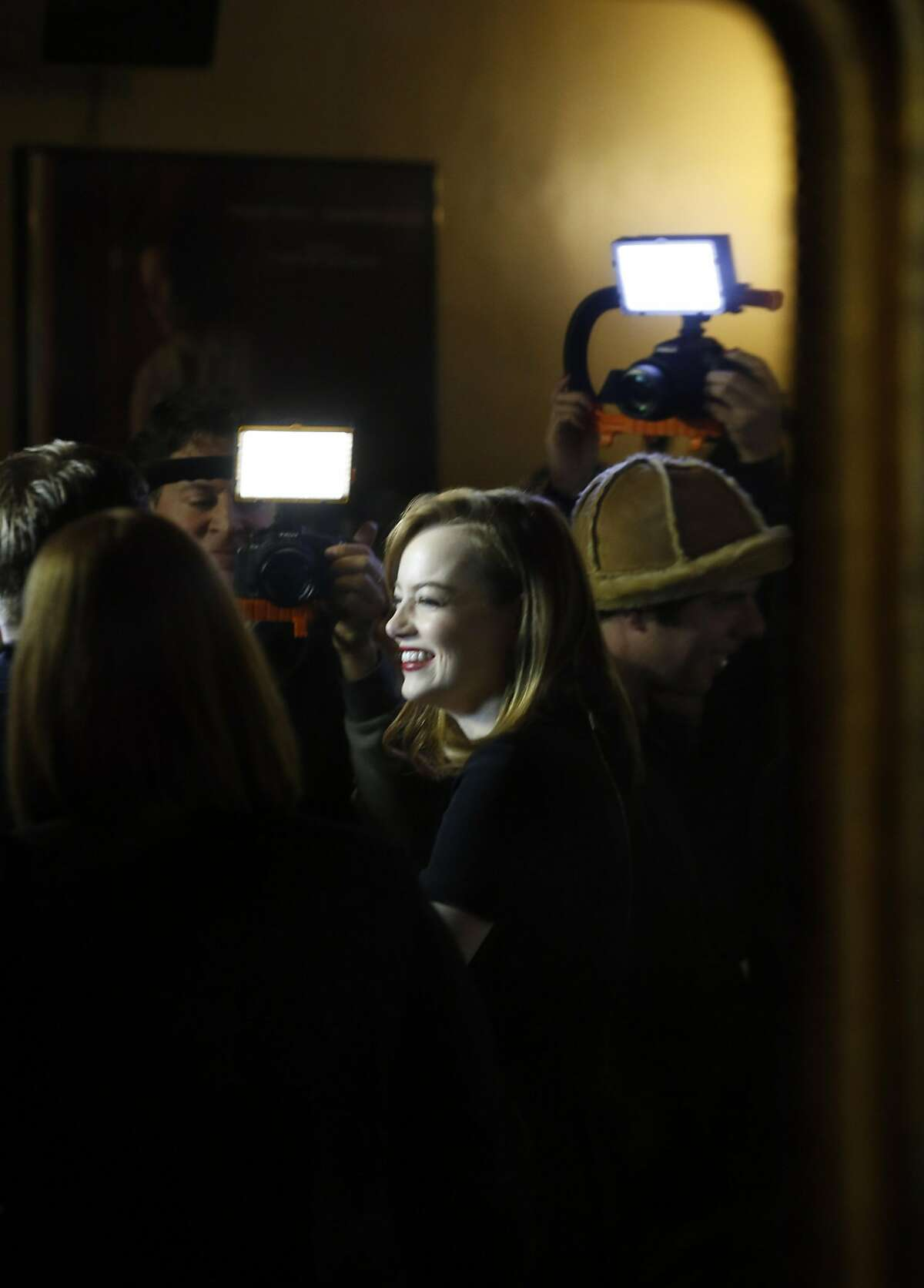 Actress Emma Stone is reflected in a mirror as she is interviewed before a special screening of La La Land at the Castro Theater in San Francisco, Calif., on Thursday, December 8, 2016. The SF Film Society honored LaLa Land with a special screening at the Castro with director Damien Chazelle and stars Ryan Gosling and Emma Stone.