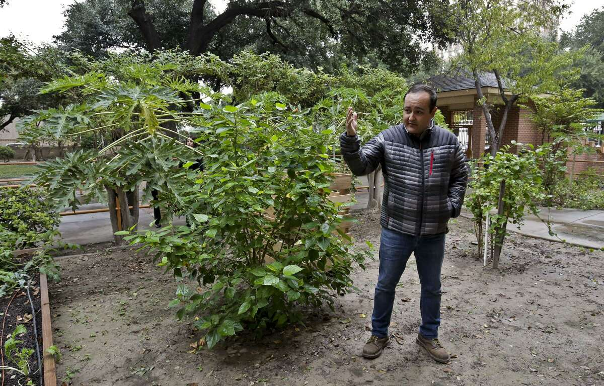 In this December file photo, Berman Rivera, from City Garten Landscape Design, gives a tour of the community garden located at the Laredo Senior Citizens Home.