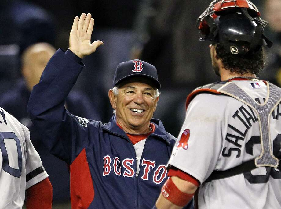 Boston Red Sox manager Bobby Valentine, left, greets catcher Jarrod Saltalamacchia after the team beat the Seattle Mariners in a baseball game Tuesday, Sept. 4, 2012, in Seattle. The Red Sox won 4-3. (AP Photo/Elaine Thompson) Photo: Elaine Thompson / ASSOCIATED PRESS / AP2012