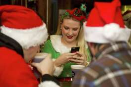 Kristen Lalli hangs out dressed as an elf at Murphy's during Stamford SantaCon on Saturday, December 6, 2014.
