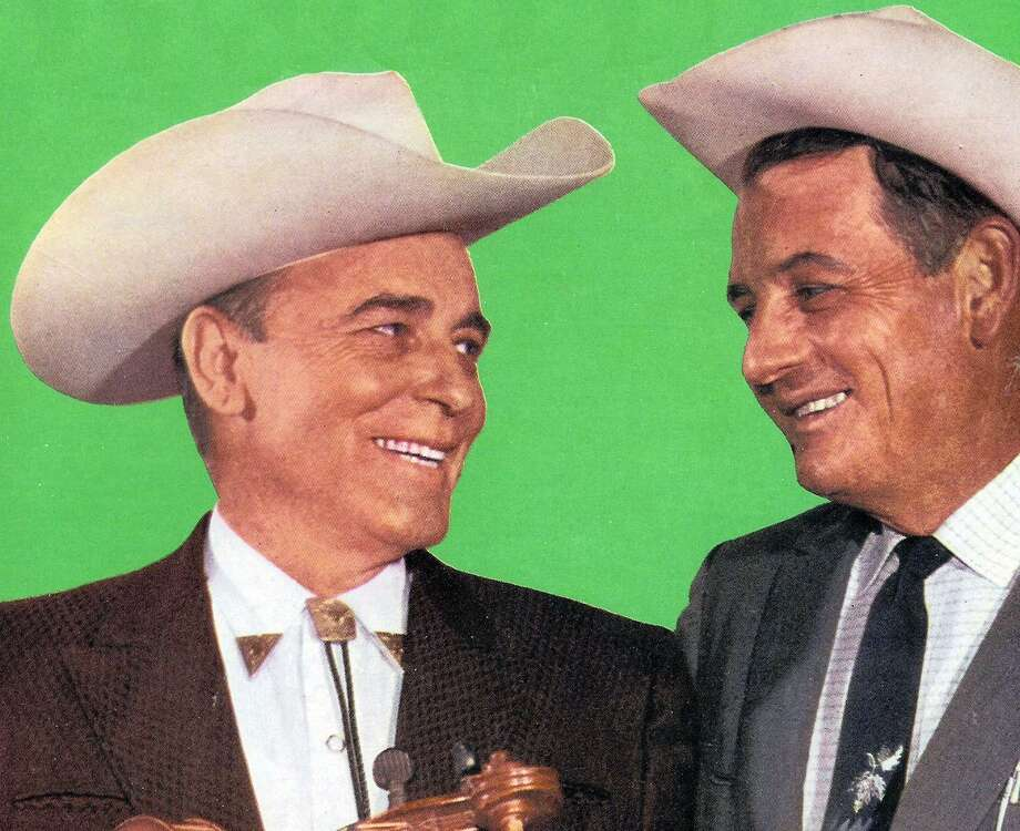 Texas swing legend Bob Wills (left) and singer Tommy Duncan, one of the founding members of Bob Wills and the Texas Playboys, circa 1965. Photo: RJ /Getty Images / 1965 GAB Archive