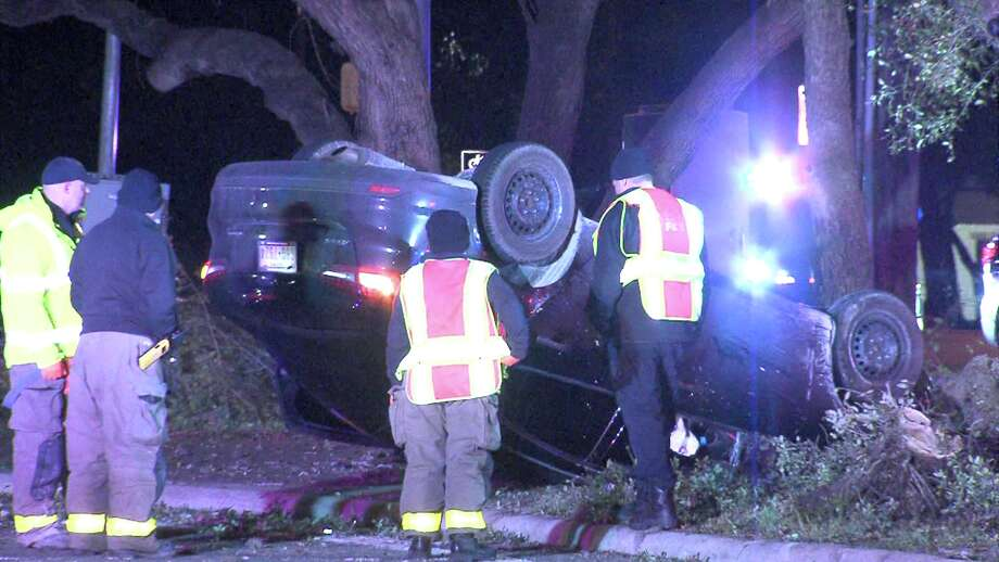 A man suffered minor injuries Dec. 9, 2016, during a rollover crash on Wurzbach Parkway. Photo: Ken Branca