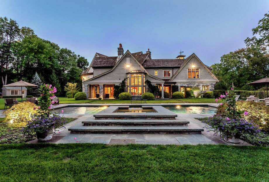 "The colonial house at 35 Charter Oak Lane has as much ""curb"" appeal from the rear view as from the front; one indication of the level of detail that is found throughout the home's interior and surrounding property. The attractively landscaped yard includes a Gunite heated in-ground swimming pool and spa."