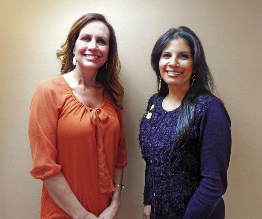 Celida Cone, left, and Cathy Trevino will supervise the new office in Dayton.