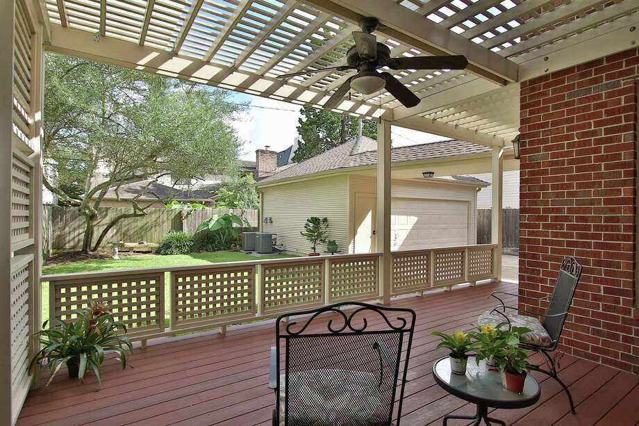 This is a deck with vinyl pergola by Abbott Contracting. Photo: Courtesy Of Abbott Contracting