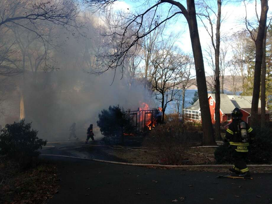Danbury firefighters battle a structure fire at 70 Forty Acres Road Friday morning. Photo: Dirk Perrefort /The News-Times