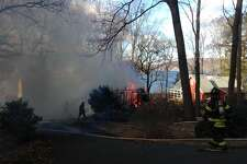 Danbury firefighters battle a structure fire at 70 Forty Acres Road Friday morning.