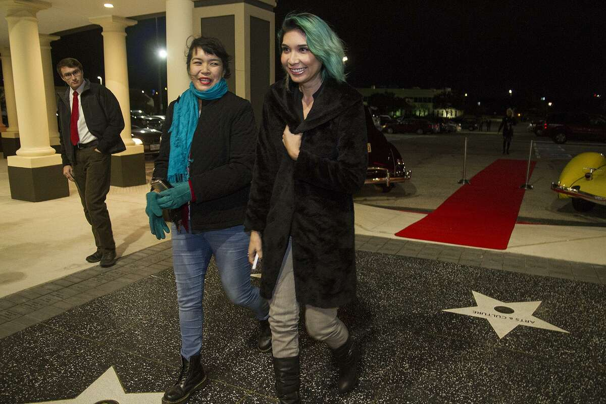 Guests Jessica Mosqueda (left) and Burgundy Woods arrive at the VIP unveiling of the newly renovated Santikos Embassy Theater.