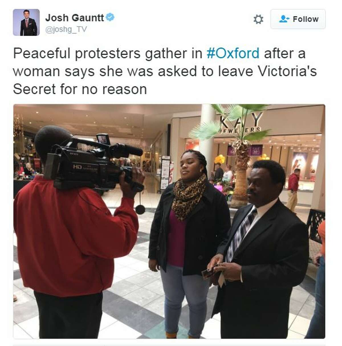 Protesters show support for the woman who was kicked out of a Victoria's Secret.