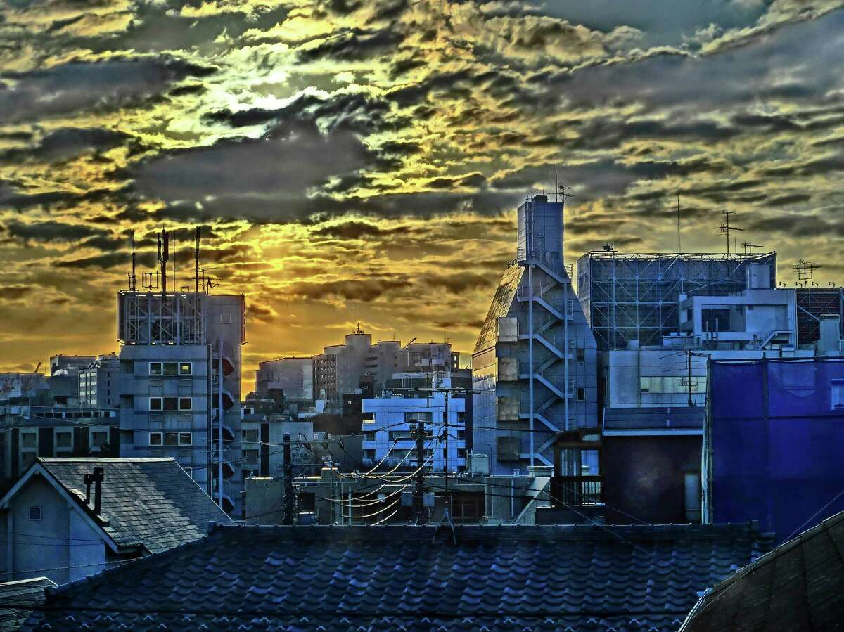 """Among works in the show """"In the Wake: Japanese Photographers Respond to 3/11,"""" at Asia Society Texas Center: """"Morning Glow"""" from the series """"2011 Phenomena: Phenomena, Chaos, Clouds, Sun, Moon,"""" by Kawada Kikuji."""
