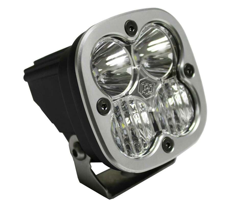 The Baja Designs Squadron R Sport off-road light for motorcycles, ATVs, SUVs and light trucks delivers 1,800 lumens and uses a hard-coated polycarbonate front lens and comes with an aircraft-grade aluminum housing, wiring harness and mounting bracket. Photo: Baja Designs