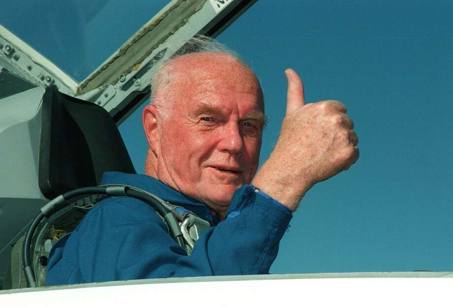 """(FILES) This NASA file photo taken on October 26, 1998 shows US astronaut and senator John Glenn arriving at the Kennedy Space Center for his 29 October scheduled launch aboard the US Space Shuttle Discovery. Glenn, who made history twice as the first American to orbit the Earth and the first senior citizen to venture into space, has died at the age of 95, the Ohio State University's John Glenn College of Public Affairs said on December 8, 2016. / AFP PHOTO / NASA / HO / RESTRICTED TO EDITORIAL USE - MANDATORY CREDIT """"AFP PHOTO / NASA"""" - NO MARKETING NO ADVERTISING CAMPAIGNS - DISTRIBUTED AS A SERVICE TO CLIENTS  HO/AFP/Getty Images Photo: HO, Stringer / AFP/Getty Images / AFP"""