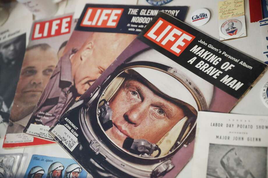 A Sept. 1966 edition of LIFE Magazine bearing the likeness of John Glenn rests in a showcase at the John & Annie Glenn Museum, Friday, Dec. 9, 2016, in New Concord, Ohio. Glenn was the first American to orbit Earth, piloting Friendship 7 around the planet three times in 1962. Glenn, as a U.S. senator at age 77, also became the oldest person in space by orbiting Earth with six astronauts aboard shuttle Discovery in 1998. (AP Photo/John Minchillo) Photo: John Minchillo, STF / Associated Press / AP