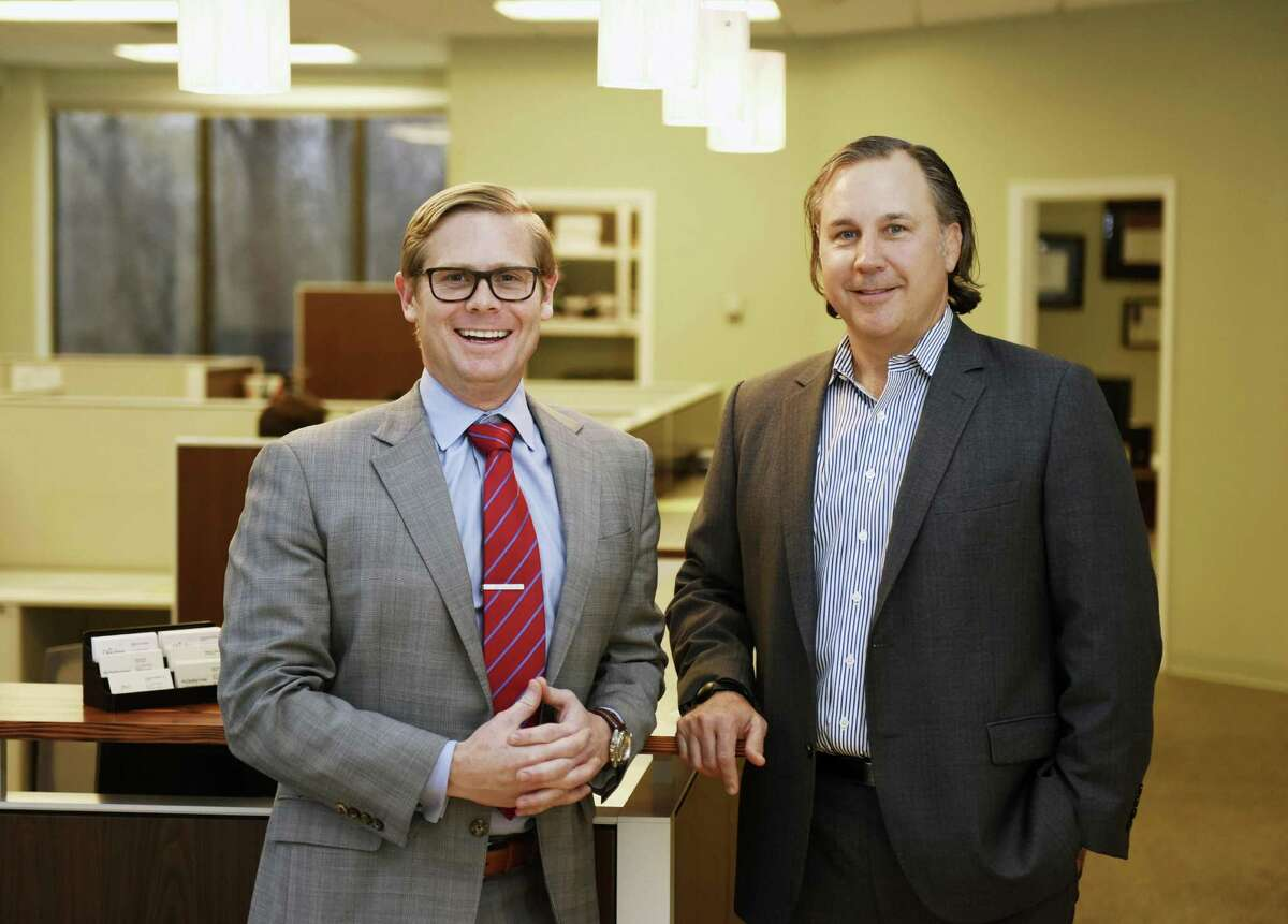 Dowling Group President Sean Dowling, left, and partner William Ludington at the group's office in the Riverside section of Greenwich. Ludington was recently hired to direct the wealth management firm's business department to try to expand the clientele.
