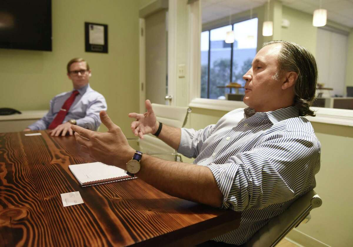 """The Dowling Group """"offers something different from big-name shops,"""" said partner William Ludington, right, with the firm's president, Sean Dowling, at their Greenwich offices."""