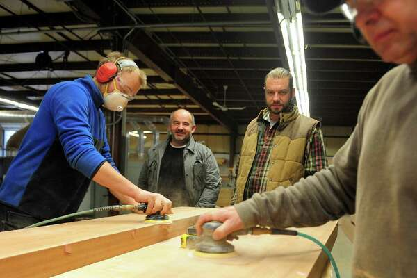 CT Moldings owners Daiusz Franek, in back at left, and Ryszard Klos pose at the new facility on Bishop Avenue in Bridgeport, Conn. on Wednesday Dec. 7, 2016. They offer high-end crown molding and a range of other products like cabinets and furniture.