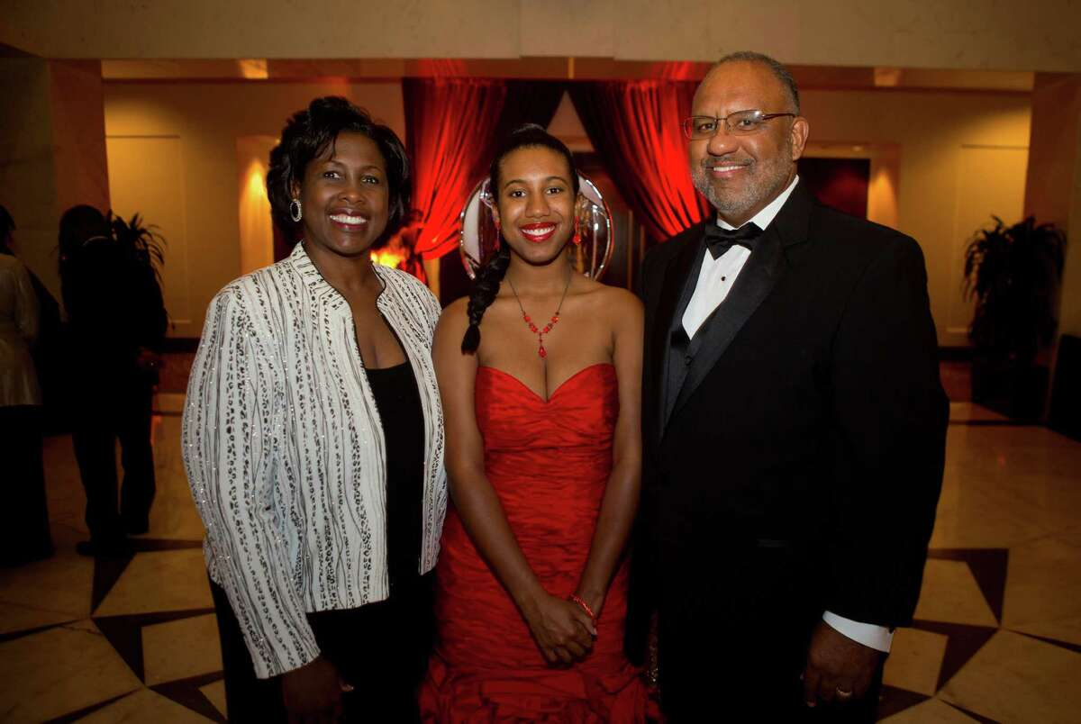 Scholarship recipient Elzia Broussard, center, stands with her parents Chinita and Michael Broussard