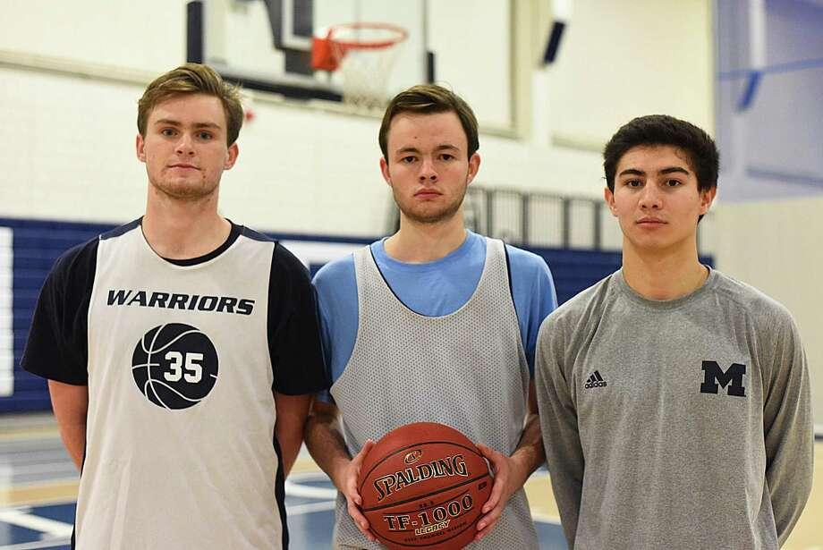 Wilton senior tri-captains for the 2016-17 boys basketball season are, from left, Jack Williams, Jack Wood and Matt Kronenberg. Photo: John Nash / Hearst Connecticut Media / Norwalk Hour