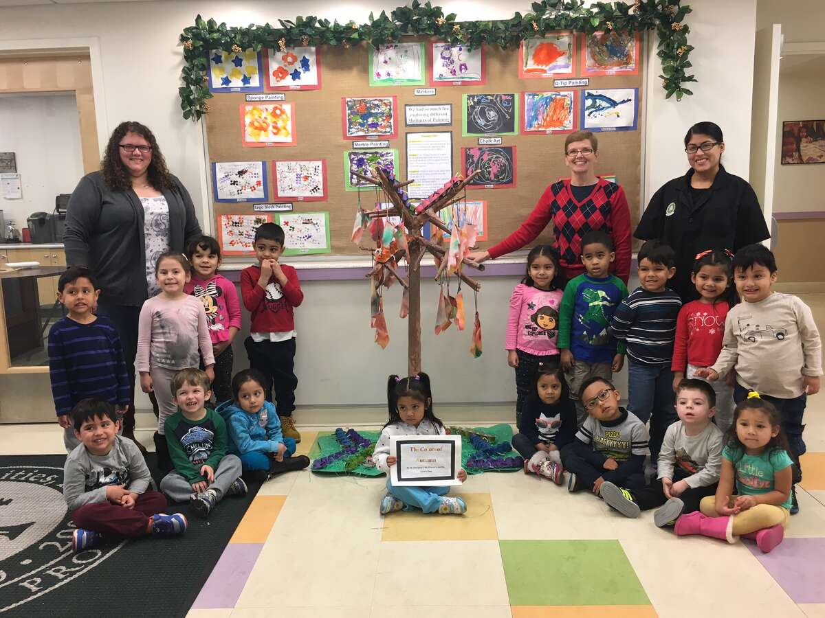Ms. Dempsey's, Ms. Kristen's, and Ms. Aylin's class with their winning project, 'The Color of Autumn.'