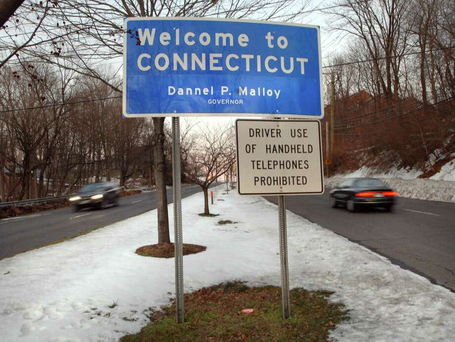 A snowy thoroughfare greets visitors in Greenwich, Conn. In 2014, the U.S. Census Bureau estimated nearly twice as many people moving to Fairfield County from New York City and surrounding cities and towns as the number of local residents heading in the opposite direction. Photo: Bob Luckey / ST / Greenwich Time
