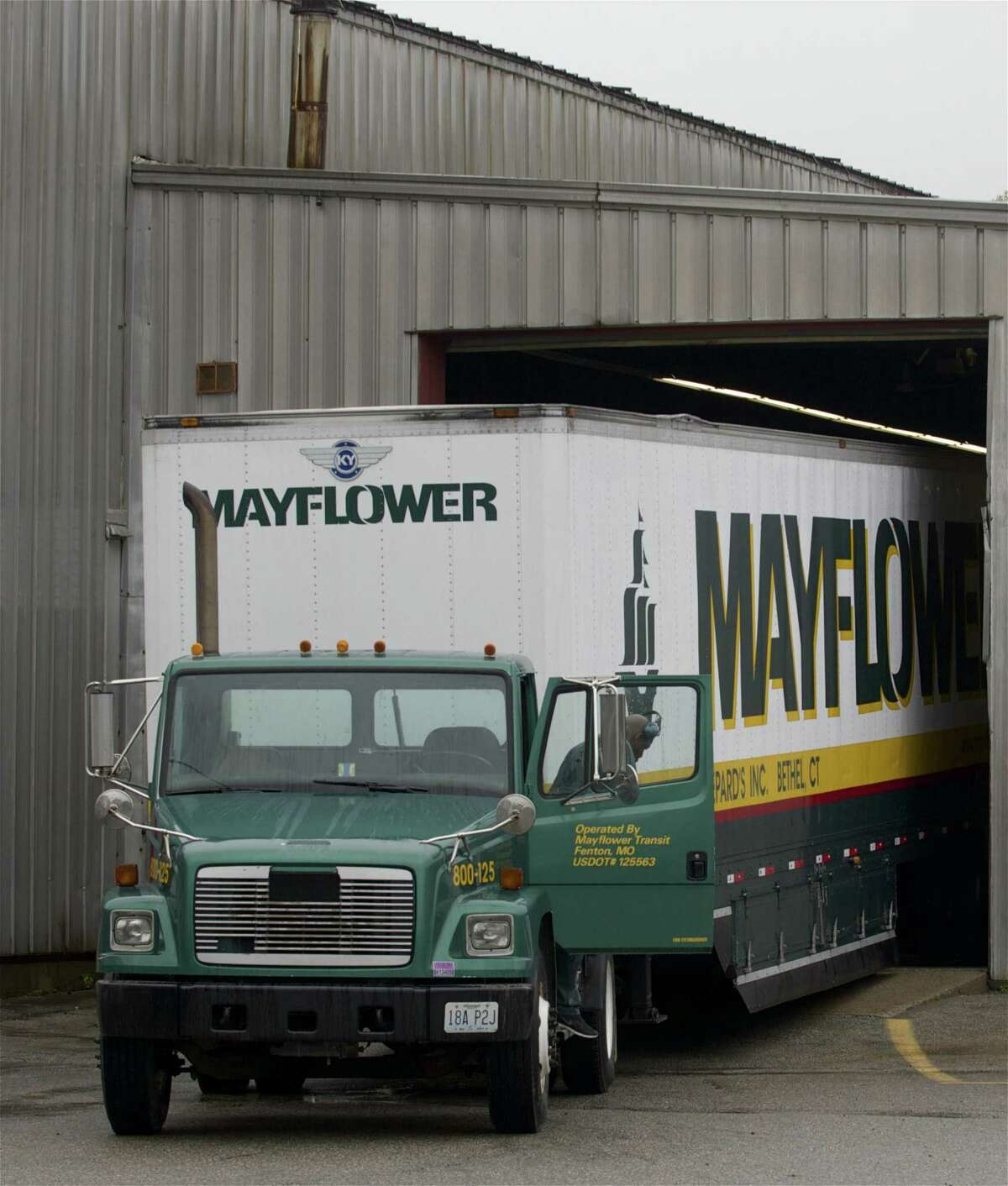 A Mayflower truck loads household belongings at Shepard's, a moving company in Bethel, Conn that provides home relocation services.