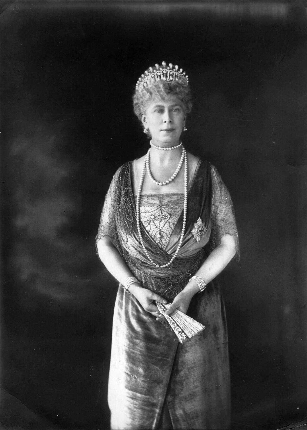 Circa 1926: Queen Mary wife of George V, the King of England wears the Cambridge Lovers Knot.