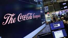 Coca-Cola said Friday that CEO Muhtar Kent will step down as CEO next year and be replaced by Chief Operating Officer James Quincey.