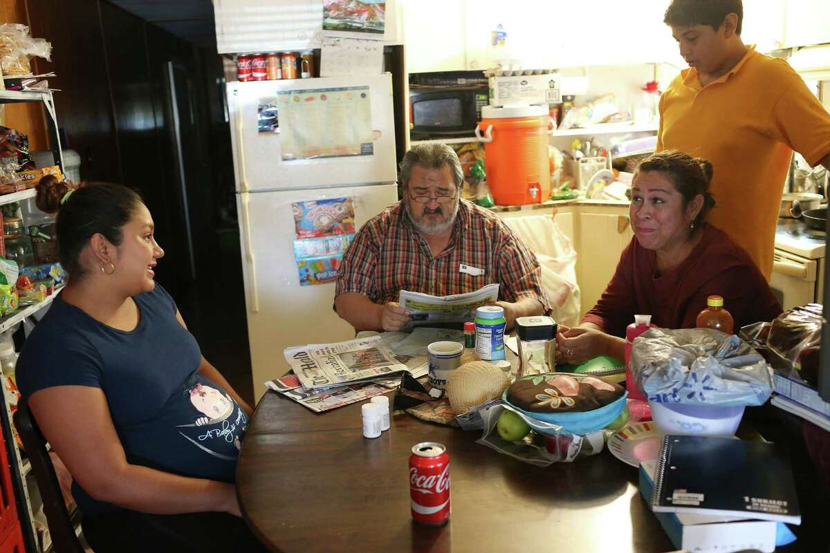 Two weeks from giving birth, Miriam Hernandez, 25, left, sits with her uncle and aunt at a trailer park in Brownsville, Texas, Thursday, Sept. 8, 2016. With her are from left, Raymundo Hernandez, 50, Esmeralda Hernandez, 45 and their son, Franco, 14. The Zika virus is a higher risk for pregnant women because is can cause microcephaly in the newborn. The Zika virus has not been detected in the Rio Grande Valley mosquito population. The dengue virus, which is carried by the same mosquito as Zika, has been detected in the Rio Grande Valley in past years