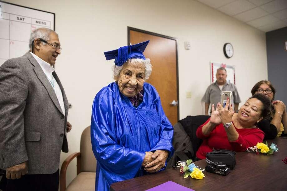 Guadalupe Segovia, 90, smiles during graduation for the Elvira Cisneros Senior Community Center's first English as a Second Language class in San Antonio, Texas on December 8, 2016. Photo: Carolyn Van Houten / Carolyn Van Houten / 2016 San Antonio Express-News