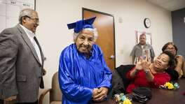 Guadalupe Segovia, 90, smiles during graduation for the Elvira Cisneros Senior Community Center's first English as a Second Language class in San Antonio, Texas on December 8, 2016.
