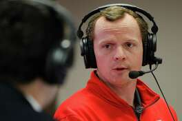 In this Feb. 4, 2015 photo, Houston's offensive coordinator Major Applewhite speaks during a webcast in Houston. Applewhite was hired to replace Tom Herman as coach at Houston on Friday, Dec. 9, 2016.