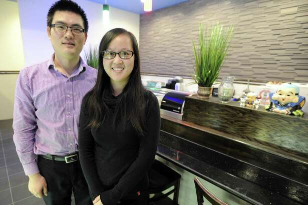 Kenny Sun and his wife, Tiffany Tian, owners of Blue Ginger, an Asian fusion restaurant, at its new location on East Main Street in Stamford.