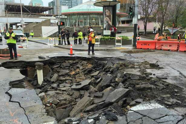 Crews work to repair damage caused by the broken water main at Fourth and Howard streets.