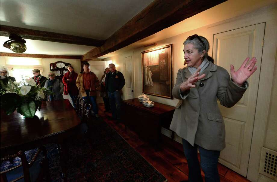 Andrea Cross describes her pre-revolutionary colonial home at 46 Kings Highway North in Westport, Conn. as homeowners and Westport Historical Society docents have a pretour Saturday, December 3, 2016, of the houses included in the Westport Historical Society 23rd Annual Holiday House Tour which takes place Sunday. Photo: Erik Trautmann / Hearst Connecticut Media / Norwalk Hour