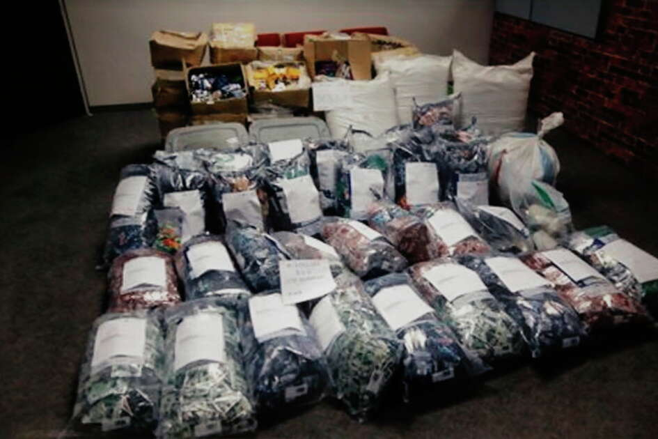 Copy photos showing a large amount of Kush that was recovered after a bust, on display as Mayor Sylvester Turner spoke during a press conference to announce a large Kush bust at City Hall, Friday,Dec. 9, 2016 in Houston.