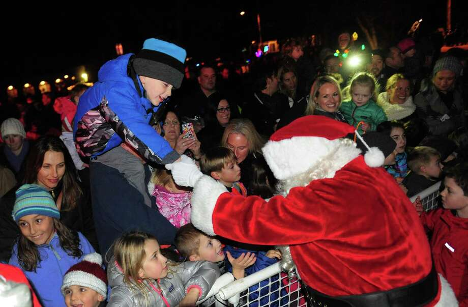 Fairfield held its annual lighting of the Christmas tree on the Town Hall Green in Fairfield, Conn. on Friday Dec. 2, 2016. The festivities began at 5:55 pm with the Fairfield Woods, Roger Ludlowe and Tomlinson Middle School Chamber Choirs singing songs of the season. The Fairfield Warde Choral Group performed at 6:20 and The Downtown Theatre Company rounded out the performances at 6:45. People in attendance enjoyed some hot chocolate and free glow necklaces compliments of the Town Youth Council. After the performances, First Selectman, Mike Tetreau did the countdown to light the tree at 7:00 pm. Photo: Christian Abraham / Christian Abraham / Connecticut Post