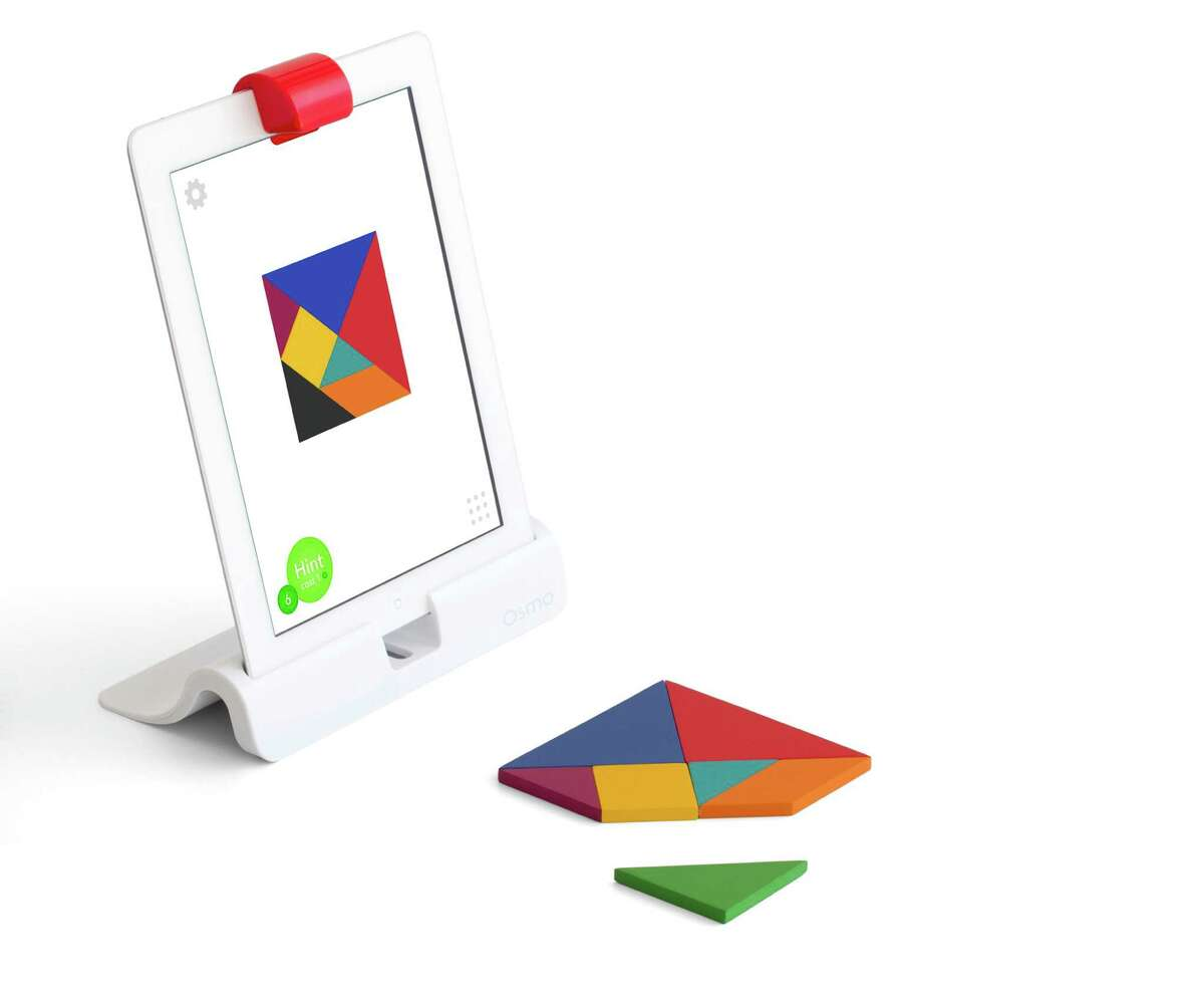 This photo provided by Osmo shows an Osmo Creative Set. Toys that teach arenÂ?'t a new thing, but a growing number are calling for kids to build with blocks, circuits or everyday items before reaching for a tablet screen. (Osmo via AP)
