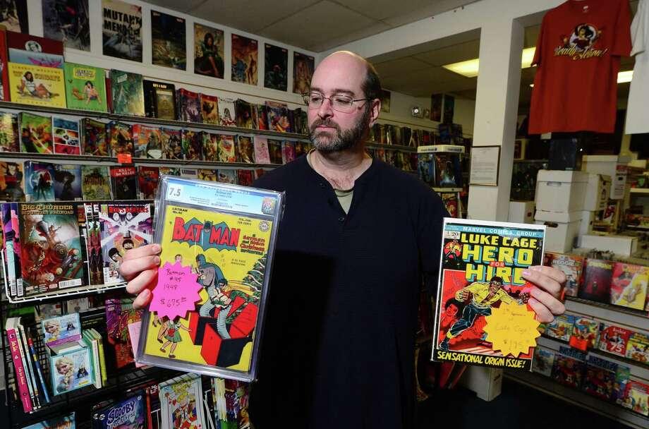 David Kruseski displays rare Batman and Luke Cage comics at his shop, Heroes Comics & Cards, in Norwalk. Photo: Erik Trautmann / Hearst Connecticut Media / Norwalk Hour
