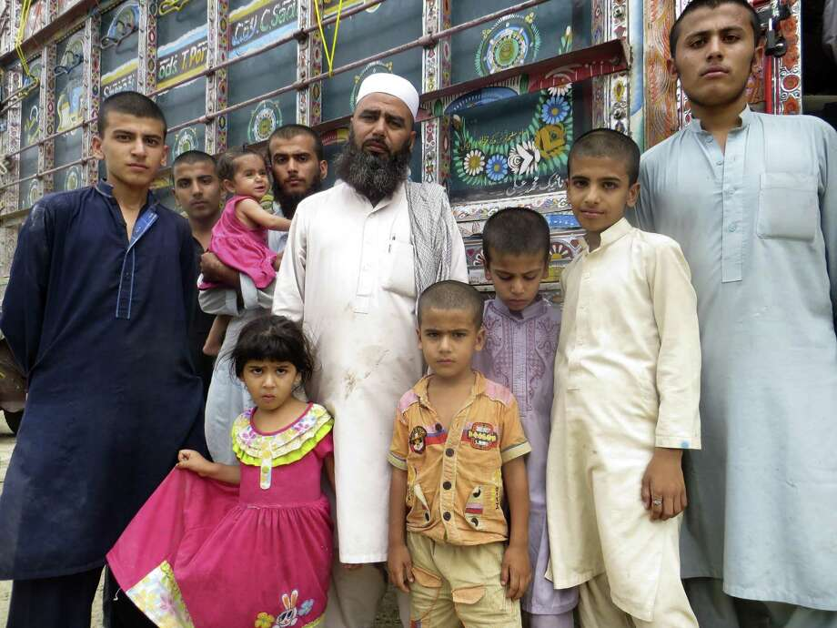 Abdul Yousufzai, who was brought to Pakistan by his parents as a toddler in 1979, was forced to return to his native Afghanistan by the Pakistan government in September. He is shown with members of his extended family at the border crossing in Torkham, where hundreds of thousands of Afghan refugees will re-enter the country from Pakistan in the coming year. Martin Kuz/San Antonio Express-News Photo: Martin Kuz, Staff / San Antonio Express-News / San Antonio Express-News