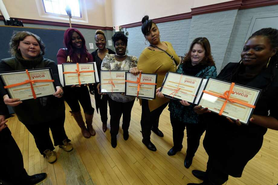 Graduates of the Jamison-Rounds Ready for Work program show off their diplomas after the ceremony at the YWCA of the Greater Capital Region Friday Dec. 9, 2016 In Troy, N.Y. The graduates from left; Sara Nichols, Paradise Neville, executive director Daquetta Jones, Tonya Harrison, Lataie McCall, Mickey Stockholm and Geneva Jones.   (Skip Dickstein/Times Union) Photo: SKIP DICKSTEIN / 20039088A