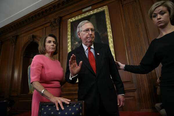 WASHINGTON, DC - DECEMBER 08: U.S. Senate Majority Leader Mitch McConnell (R) (R-KY) waves goodbye after speaking with House Minority Leader Rep. Nancy Pelosi (L) (D-CA) following an event marking the passage of the 21st Century Cures Act at the U.S. Capitol December 8, 2016 in Washington, DC. The bill, passed with strong bipartisan support, provides funding for cancer research, the fight against the epidemic of opioid abuse, mental health treatment, aids the Food and Drug Administration in expediting drug approvals and pushes for better use of technology in medicine. (Photo by Win McNamee/Getty Images)