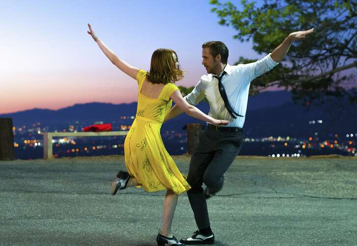 """This image released by Lionsgate shows Ryan Gosling, right, and Emma Stone in a scene from, """"La La Land."""" (Dale Robinette/Lionsgate via AP)"""