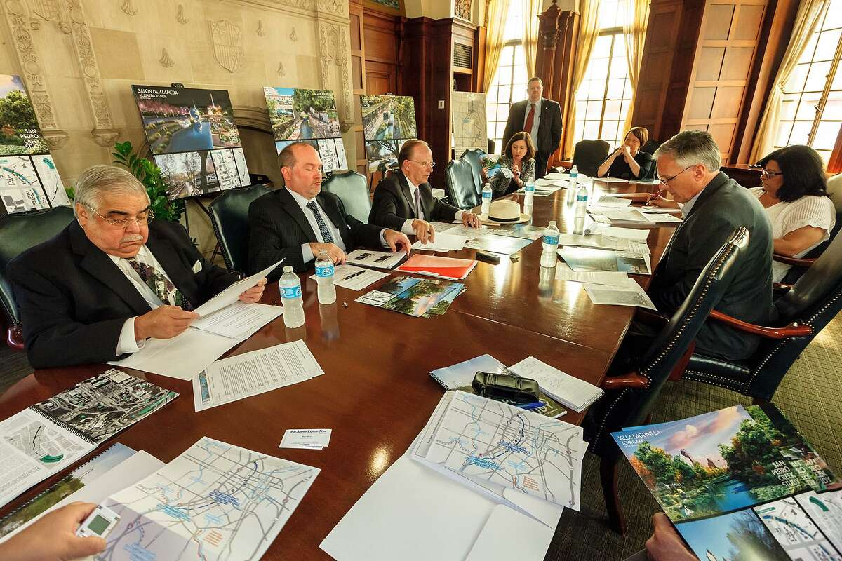 A front-row seat to the city's progress for 36 years: Bruce Davidson (right front) attends an Editorial Board meeting in 2013 on San Pedro Creek improvements. After leading the Express- News editorial pages for 12 years, the editor/columnist/reporter will step down but continue to contribute.