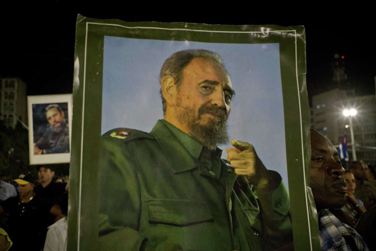 A picture of Fidel Castro is held during a rally honoring the late Cuban leader at the Revolution Plaza in Havana, Cuba on Nov. 29, 2016.