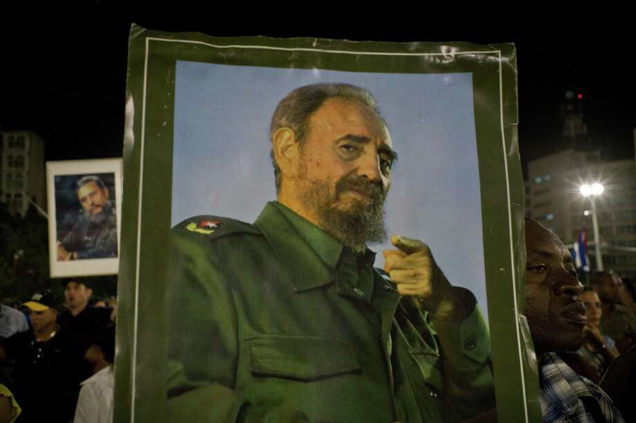 A picture of Fidel Castro is held during a rally honoring the late Cuban leader at the Revolution Plaza in Havana, Cuba on Nov. 29, 2016. Photo: Ramon Espinosa /Associated Press / Copyright 2016 The Associated Press. All rights reserved.