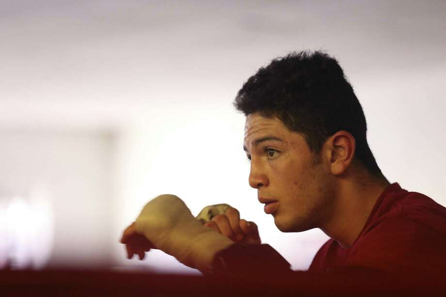 """Cresencio Ramos Jr. works out at the Premier Boxing Club on Oct. 12, 2016. Ramos is a junior at UTSA studying kinesiology. Ramos, 22, is also a boxer whose alias is """"Kid Thunder,"""" and has nine professional fights with no losses. Photo: Jerry Lara /San Antonio Express-News / © 2016 San Antonio Express-News"""